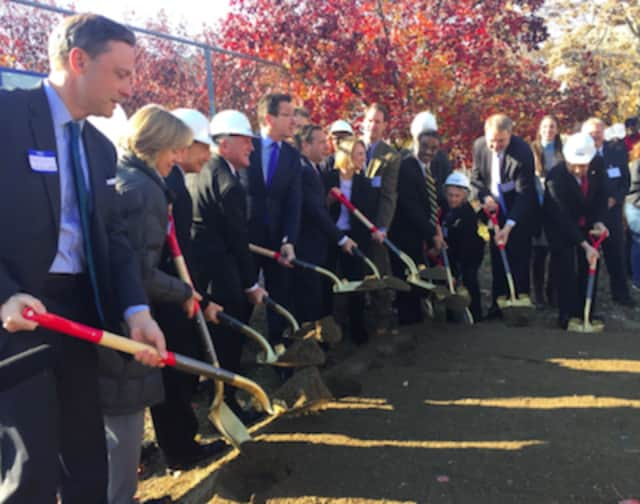 Gov. Dannel P. Malloy, center, at the groundbreaking ceremony or the Washington Village Redevelopment Project on Monday.