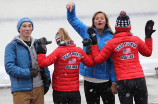Fans of Tucker West, of Ridgefield, celebrate after his gold-medal winning run Friday in Lake Placid, N.Y.