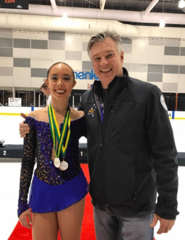 Brooklee Han, left, stands with her coach, Peter Cain, after winning a silver medal at the Australia Figure Skating Championships.