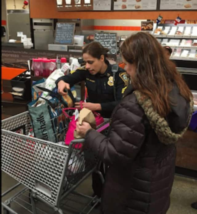 Sgt. Sofia Gulino checks with a customer on how to protect valuables from theft while shopping.