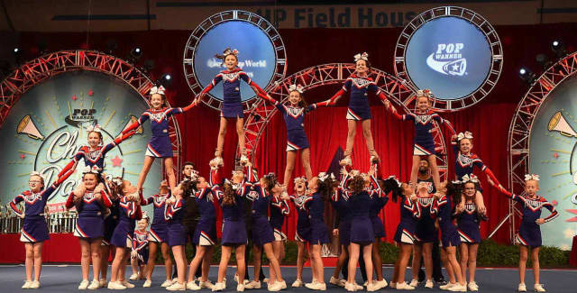 The Orange Patriot Cheerleaders place first in the nation during recent competitions at Disney in Orlando.
