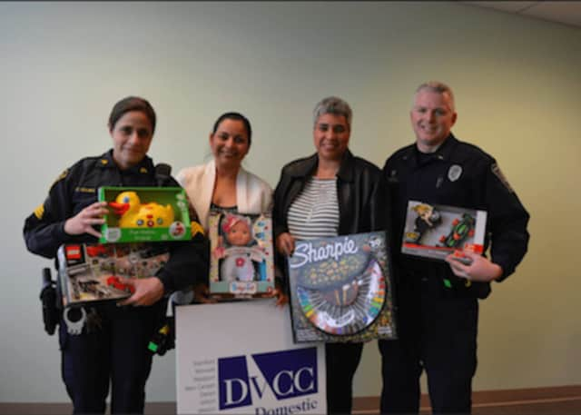 Members of the Norwalk Department of Police Service delivered numerous gifts to the Domestic Violence Crisis Center.