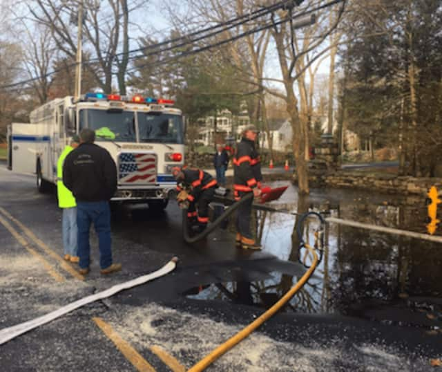 Water main break at Havemeyer Lane and Palmer Hill Road in Greenwich flooded the intersection with water and created hazardous conditions due to ice.
