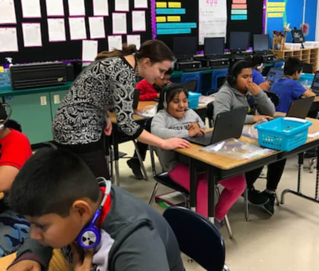Kate Dzikiewicz explains Hour of Code to students at Julian Curtiss School offered through a Bruce Museum program.