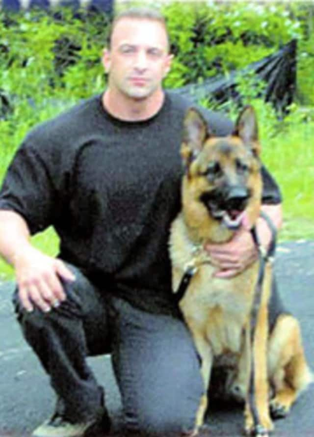 A file photo of Nick Tartaglione with a K-9 officer when Tartaglione was a member of the Briarcliff Manor Police Department.