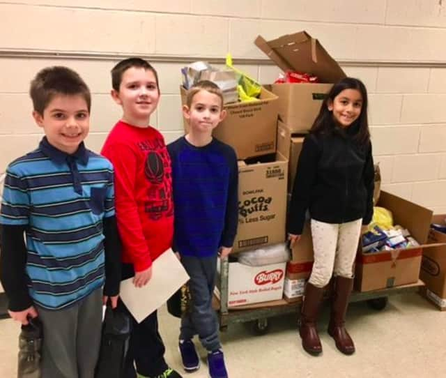 Third-graders at Pembroke Elementary School in Danbury collected food for the needy, which will be distributed by The Salvation Army.
