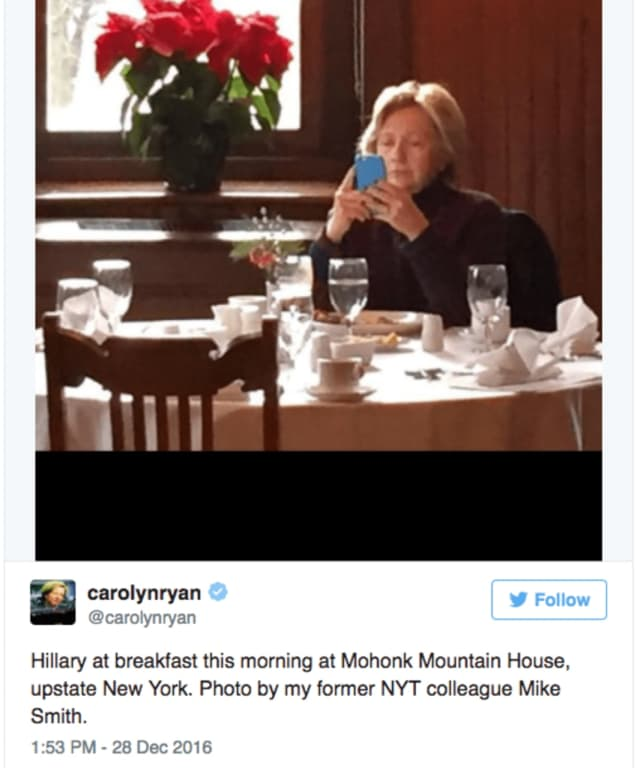 Chappaqua's Hillary Clinton was snapped having breakfast and checking her cell phone at the Mohonk Mountain House in New Paltz Wednesday. This image was tweeted by Carolyn Ryan, a New York Times editor.