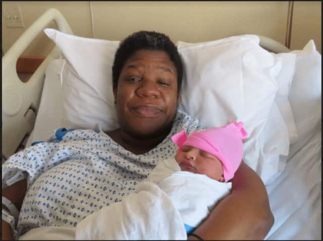 Caressa Jones welcomes her daughter, Arianna Lassus, who was born at 5:39 a.m. on New Year's Day.