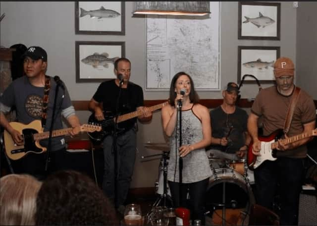 "Members of Ridgefield-based ""On The Rocks"" band: From left, Win Sakdinan (guitar), Brian Connally (bass), Erika Howard (lead vocals), John Sobocinski (drums) and Kevin Kuntz (guitar)"