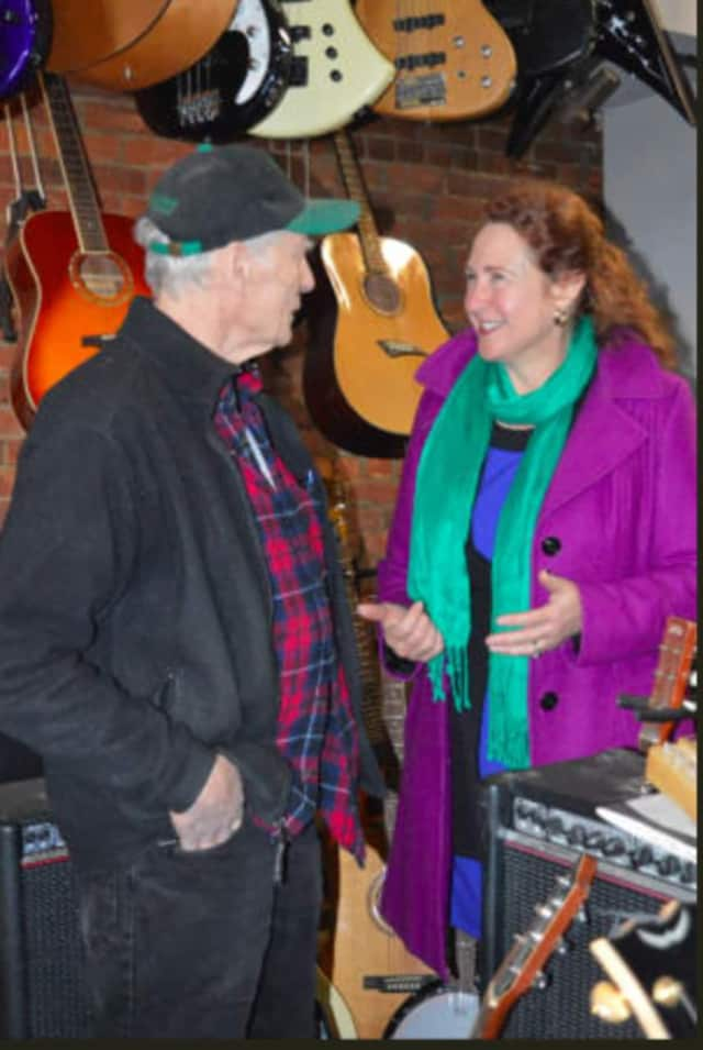 Russ Mumma, owner of the Music Guild in downtown Danbury, speaks to U.S. Rep. Elizabeth Esty (D-5th District) during her small business tour in December.