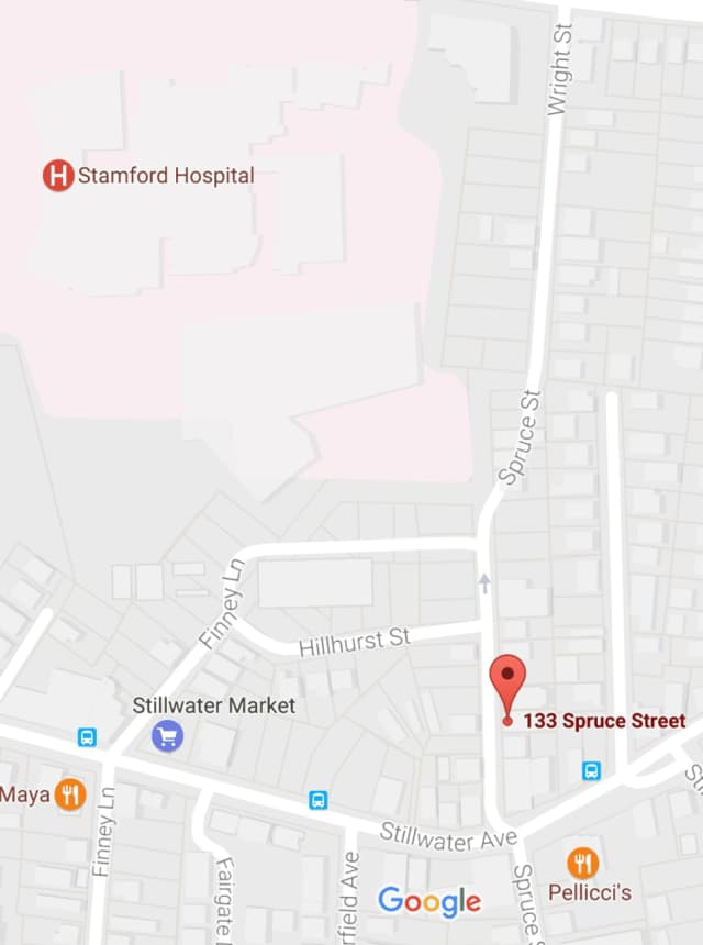 Stamford police were investigating a site on Spruce Street near Stamford Hospital where a man's body was found in an alleyway.