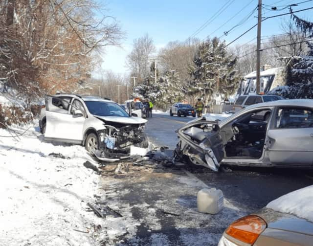 Shelton emergency response teams rushed to the scene of a two-car accident Sunday on Route 110 near Murphy's Lane.