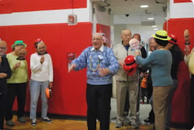 Dante Chicatell, 103, works part-time at the New Canaan YMCA. He is shown here at a Y birthday bash when he turned 100.