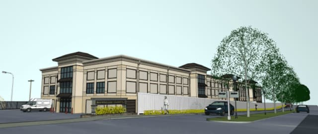 An architectural rendering of Hollow Tree Self Storage is shown here. The high-end facility being built in Darien will look residential from the outside.