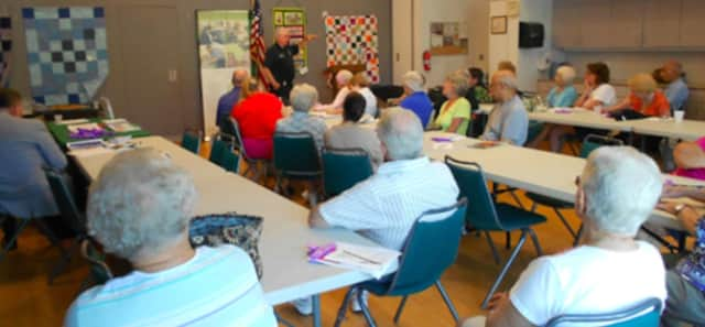 Senior citizens enjoy an event at Elmwood Hall in Danbury.
