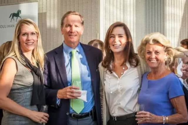 Nancy Seaman, second from right, stepped down this week from her role as chairman at Houlihan Lawrence. She is with Carolyn Perera, her husband Alan Schwartz and Sally Maloney at an one-year anniversary party for HL's Greenwich office.