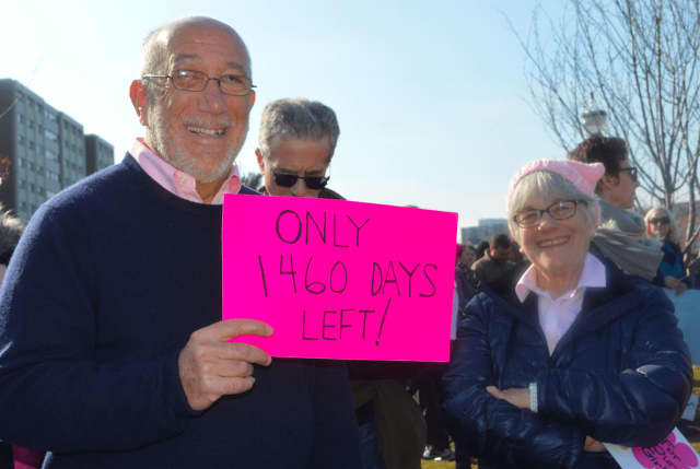 "Westport residents Stanley and Susan Witkow hold up signs at the Women's March in Stamford. The organizers of the march are planning ""My Favorite President's Day"" Sunday, Feb. 19 at the Ferguson Library."