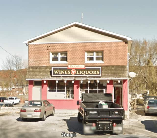 Two men robbed, vandalized and set fire to the Rooster Wine & Liquor Store at 113 S. Main St., Newtown police said.