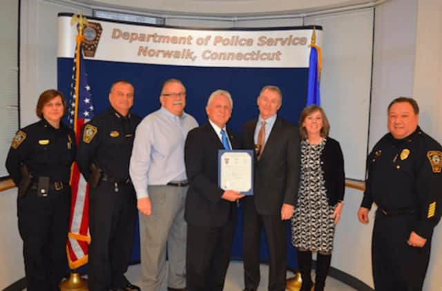 L-R Deputy Chief Zecca, Chief Kulhawik, Commissioner Yost, Mayor Rilling, Lieutenant and Mrs. Hume and Deputy Chief Gonzalez.