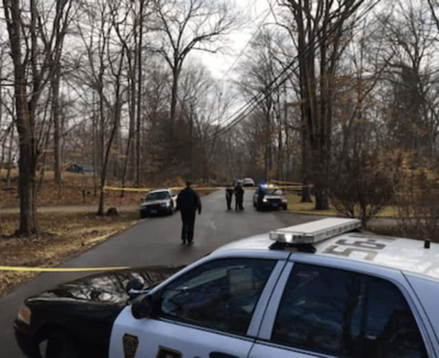 Norwalk Police tape off Geneva Road where a pursuit died after a police pursuit.