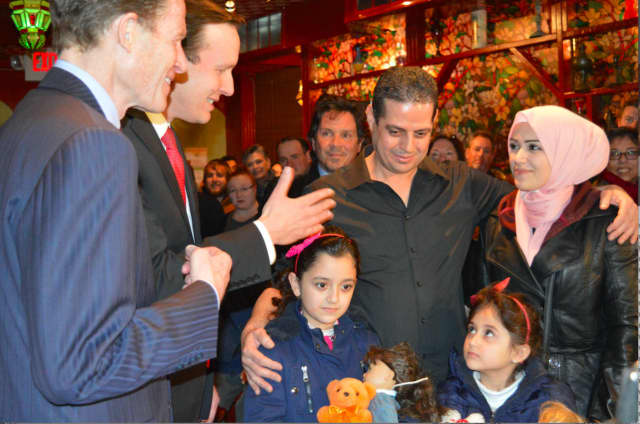 Sen. Richard Blumenthal (left) welcomes a Syrian family that had been denied entry to the U.S. due to President Donald Trump's travel ban. Blumenthal is calling on Trump to abandon any religious tests in his approach to national security.