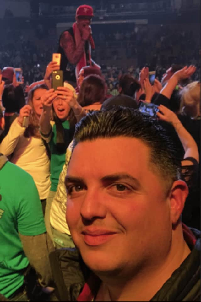 """Illario Altamura, co-founder of Parachute Concerts, at a performance of Vanilla Ice, in the """"I Love the 90s Tour"""" in Manchester, N.H., in December."""
