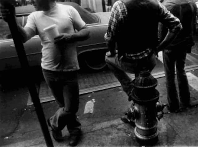 """Leon Levinstein's """"Man Holding Cup"""" is part of a new photography exhibition at the Bruce Museum in Greenwich."""