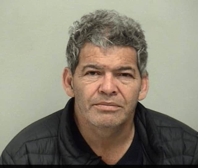 Nelson Turcios of Stratford turned himself in on Thursday, Feb.9, in response to a warrant relating to the death of a Stamford worker who fell off a three-story roof in Westport, according to Westport police.