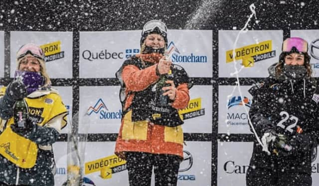 Julia Marino, center, of Westport pops the cork on another gold medal after winning a slopestyle snowboarding event Sunday in Canada.