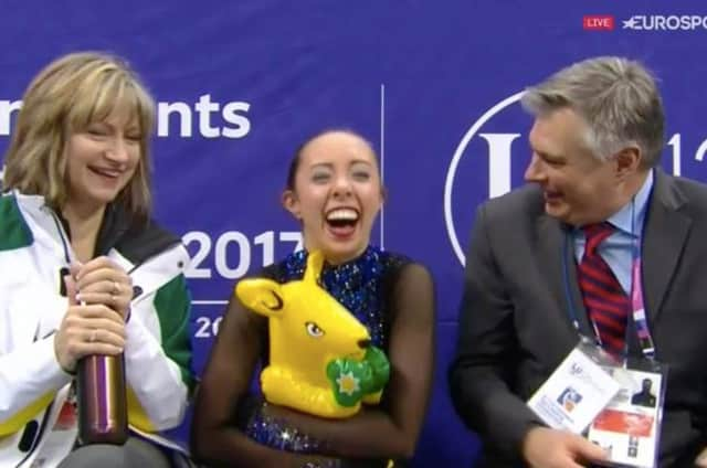 Redding's Brooklee Han, center, celebrates with coaches Darlene and Peter Cain after her free skate at the Four Continent Championships on Sunday.