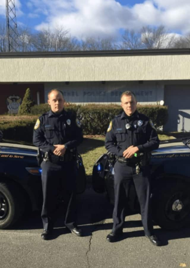 Bethel Police Officer Michael McKinney, right, who joined the Department in 2015 with Jared Robinson, revived a man who apparently overdosed on opiates on Wednesday night.