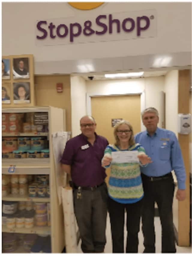 John Radaskie, front end manager for Stop & Shop, left, and  store manager Richard Marcucio donate the check to Rev. Phyllis J. Leopold, ARC Executive Director.