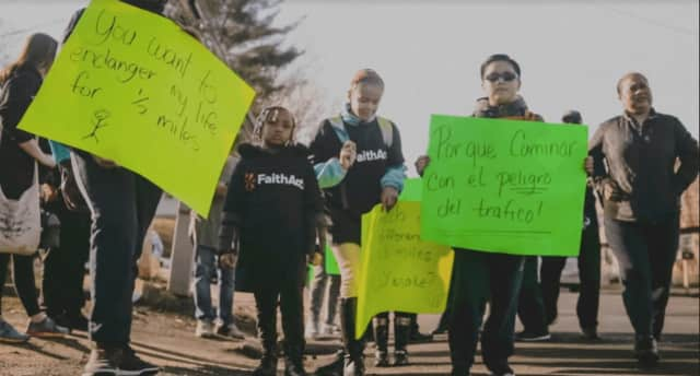 Families staged a protest walk Friday against proposed school busing changes in Bridgeport.