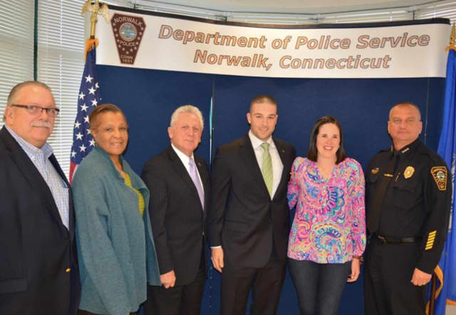 The Norwalk Police Department announced the promotion of Sergeant Justin Bisceglie (third from right).