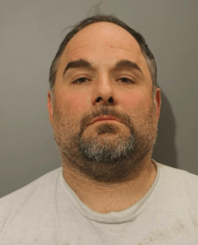 Ioannis Papakosmas is charged with offering a $1,000 bribe to a Town of Wilton official.