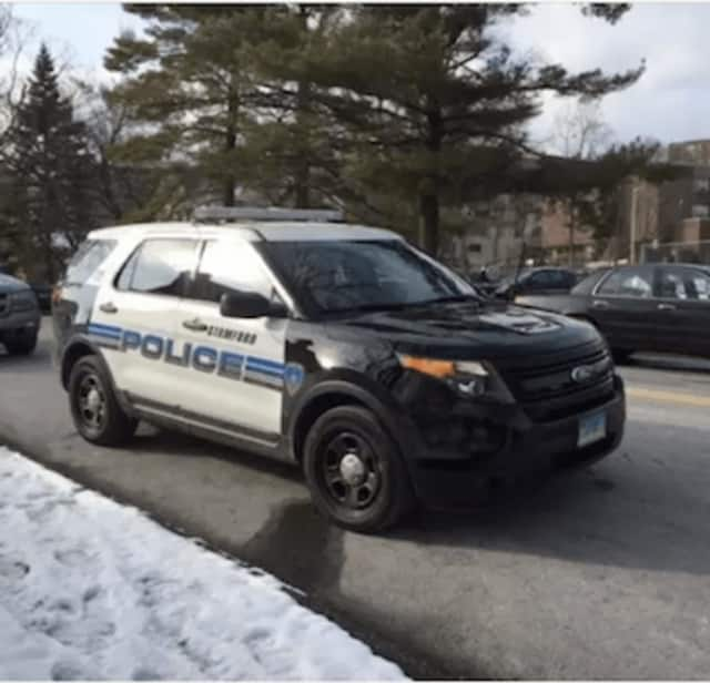Stamford Police arrested a man on charges of urinating in front of police headquarters Friday morning.