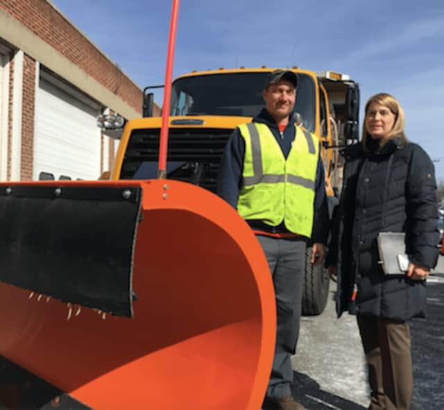 Darien First Selectman Jayme Stevenson, at right, along with David Ward, a labor/driver with the Department of Public Works standing by a snow plow that will be in use during tomorrow's anticipated blizzard.