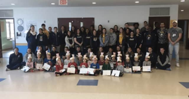 Dozens of Pace University student-athletes visited elementary school students in celebration of National Read Across America Day and Vocabulary Day.