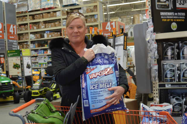 Alicia Pagel of New Milford was stocking up on items for the snow at Home Depot on Federal Road in Danbury, in preparation for the impending blizzard that's expected on Tuesday.