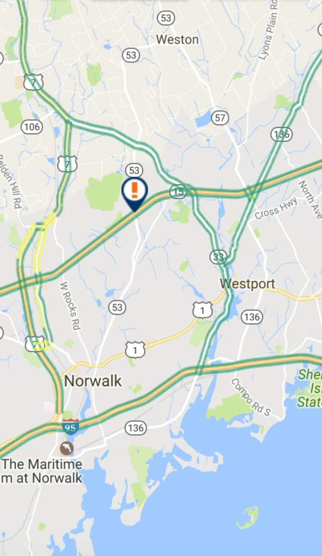 An overturned car is blocking a lane of the Merritt Parkway between Exit 40B and Exit 41 on Wednesday.