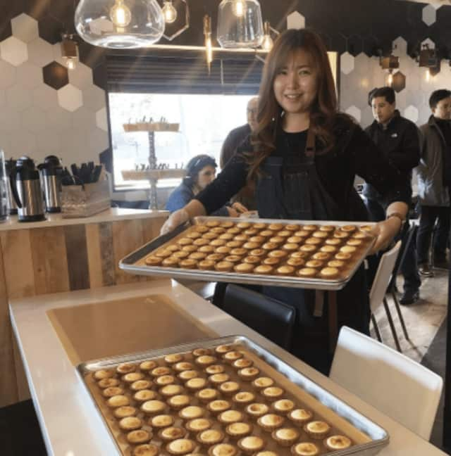 Seonah bringing out our fresh baked cream cheese honey tarts at Mavi's Coffee and Patersserie in Fort Lee.