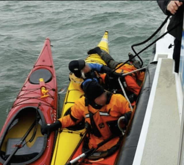 A kayaker is rescued by officers with the Greenwich Police Department's marine unit after falling out of his kayak Saturday afternoon near Great Captain's Island.