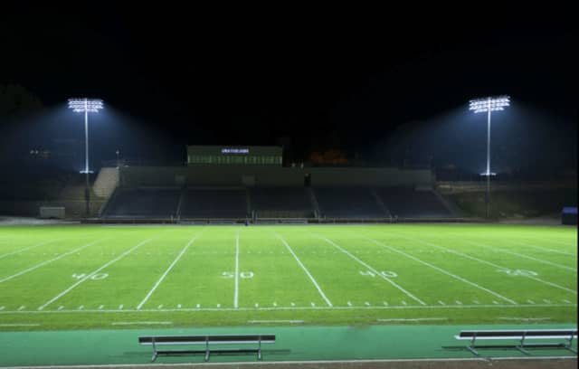 The Darien Lights Brigade needs to raise $150,000 by May 1 to reach its goal of $750,000 to have lights installed at the Darien High School football field this summer.