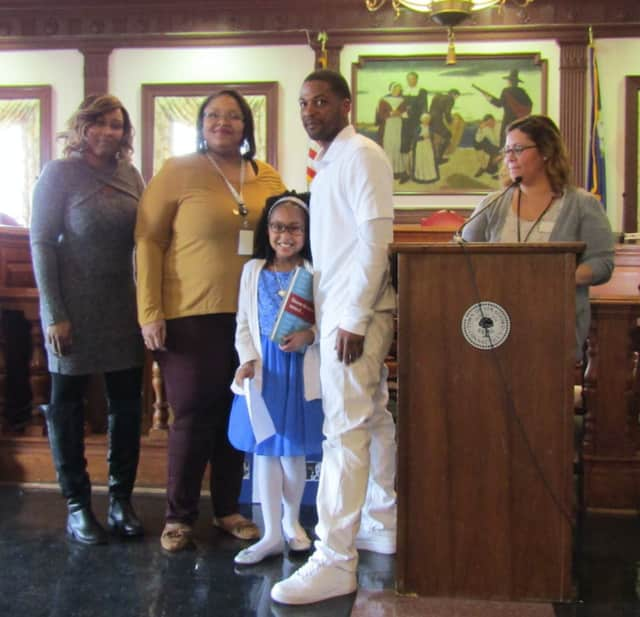 """Wilcoxson Elementary School student Ny'Asia Curry (center) was among students honored for their works of poetry, art and writing at the recent """"Black History Month"""" contest at Stratford Town Hall."""