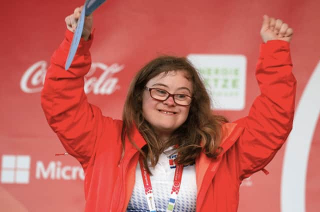 Courtney Muns, 21 of Garfield, took home 2nd place in the snowshoeing event at the World Special Olympics in Austria.