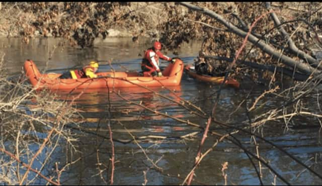 A kayak became pinned against a tree amid swift-moving water and strong winds at the center of Wappinger Creek in the Town of Poughkeepsie on Saturday.