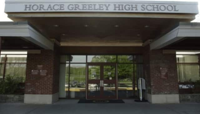 A teacher and coach from Horace Greeley High School died just days before his paid administrative leave ended.
