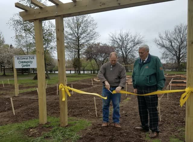 Ridgefield Park Mayor George Fosdick, right, and Ridgefield Park Green Team Chairman Mark Olson celebrate Earth Day by officially opening Ridgefield Park's new Community Garden at McGowan Park.