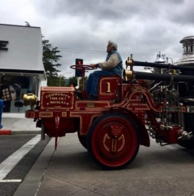 Jay Leno hit the town on an old-school Wayne firetruck.