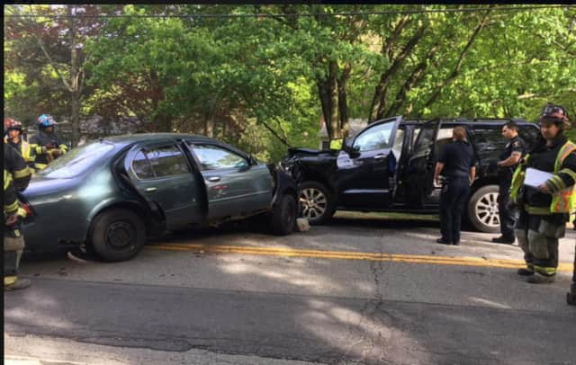 A car, left, and SUV were involved in the head-on crash